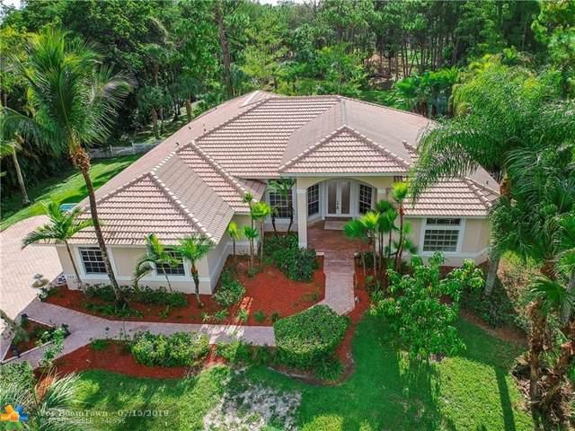 5887 NW 71st Ter, Parkland, FL 33067 (MLS #F10184790) :: Berkshire Hathaway HomeServices EWM Realty