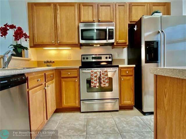 3600 Oaks Clubhouse Dr #402, Pompano Beach, FL 33069 (#F10245327) :: Posh Properties