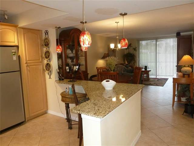 2430 Deer Creek Country Club Blvd #107, Deerfield Beach, FL 33442 (#F10267042) :: Realty One Group ENGAGE