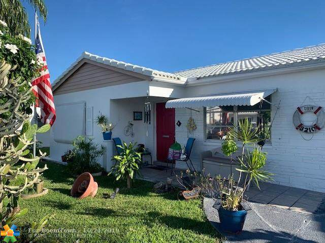 8210 NW 59th St, Tamarac, FL 33321 (MLS #F10200658) :: Berkshire Hathaway HomeServices EWM Realty