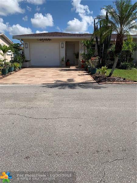 5706 NW 66th Terrace, Tamarac, FL 33321 (MLS #F10201343) :: Berkshire Hathaway HomeServices EWM Realty