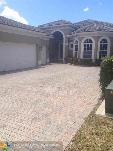 5842 NW 126th Ter, Coral Springs, FL 33076 (MLS #F10213575) :: GK Realty Group LLC