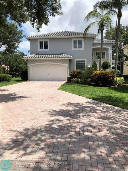 6065 NW 75th Ct, Parkland, FL 33067 (MLS #F10231823) :: GK Realty Group LLC