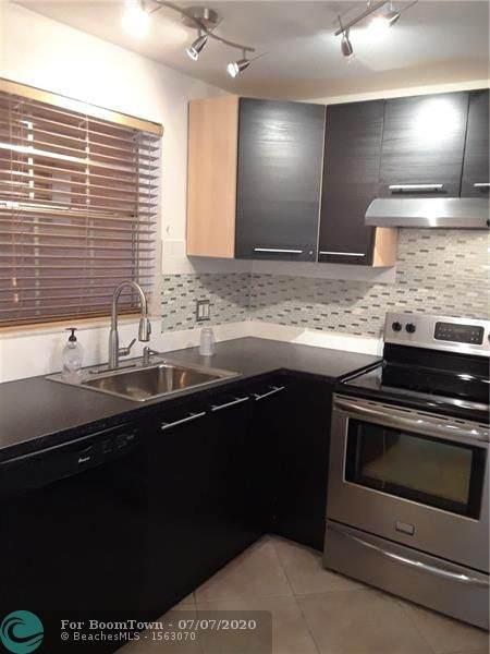 610 Tennis Club Dr #205, Fort Lauderdale, FL 33311 (MLS #F10237656) :: Berkshire Hathaway HomeServices EWM Realty