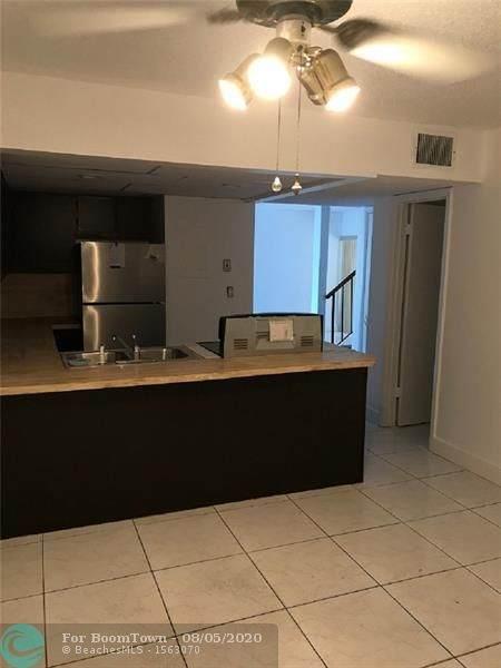 8031 Lagos De Campo Blvd L-3, Tamarac, FL 33321 (MLS #F10242524) :: Berkshire Hathaway HomeServices EWM Realty