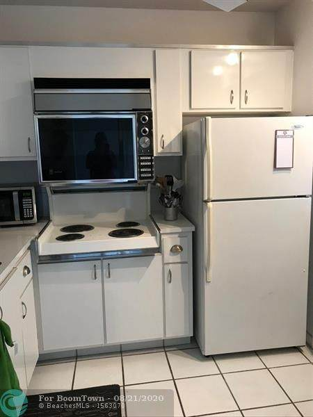 5101 NW 34th St #202, Lauderdale Lakes, FL 33319 (MLS #F10245053) :: Berkshire Hathaway HomeServices EWM Realty