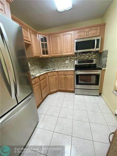 6091 NW 61st Ave #205, Tamarac, FL 33319 (#F10250810) :: Posh Properties