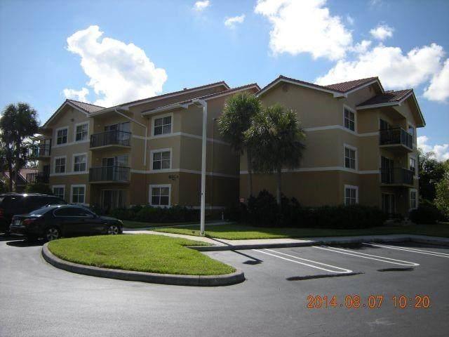9001 Wiles Rd #208, Coral Springs, FL 33067 (MLS #F10267847) :: Green Realty Properties