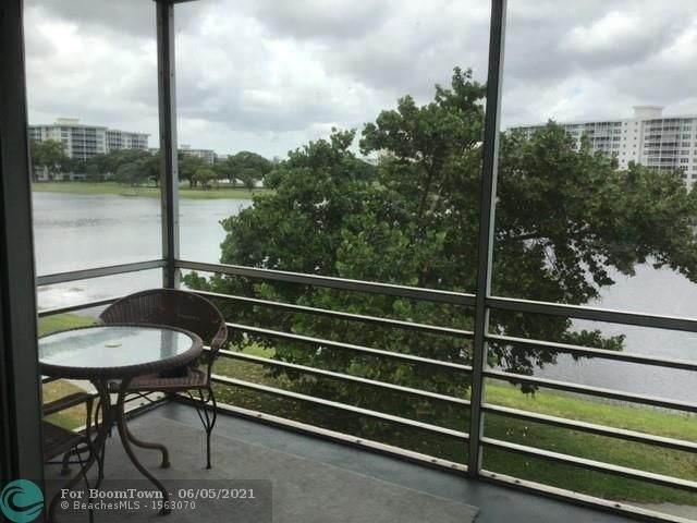 2751 N Palm Aire Dr #304, Pompano Beach, FL 33069 (MLS #F10287617) :: Berkshire Hathaway HomeServices EWM Realty
