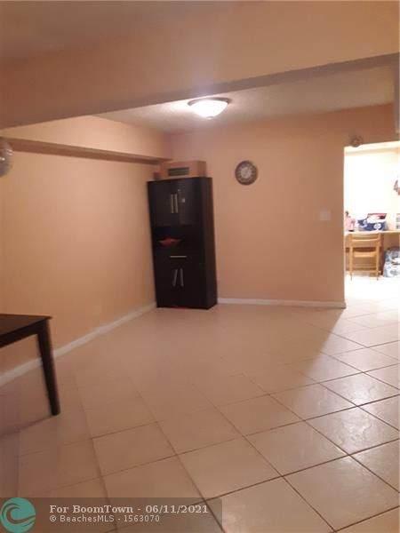 5717 NW 16th St #5717, Lauderhill, FL 33313 (MLS #F10288171) :: Berkshire Hathaway HomeServices EWM Realty