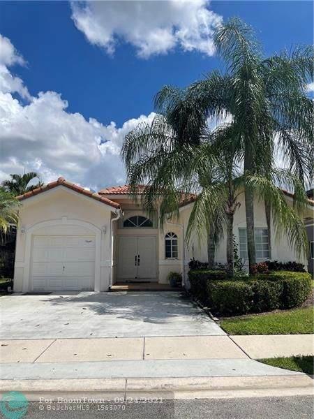 7624 NW 99th Ter, Tamarac, FL 33321 (MLS #F10301553) :: Berkshire Hathaway HomeServices EWM Realty