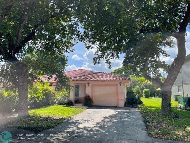 12050 NW 33rd St, Coral Springs, FL 33065 (MLS #F10301972) :: Adam Docktor Group