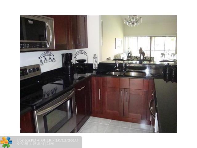 2051 SW 15th St #214, Deerfield Beach, FL 33442 (MLS #F10142790) :: Green Realty Properties
