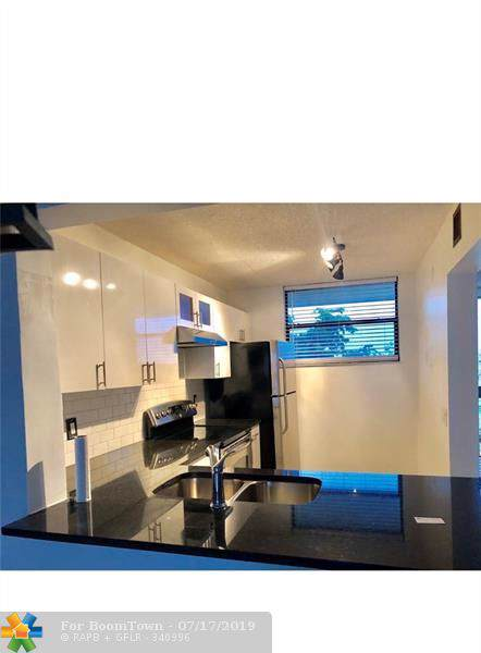 113 Lake Emerald Dr #403, Oakland Park, FL 33309 (MLS #F10181673) :: Berkshire Hathaway HomeServices EWM Realty