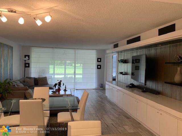 2671 S Course Dr #101, Pompano Beach, FL 33069 (MLS #F10184636) :: Berkshire Hathaway HomeServices EWM Realty