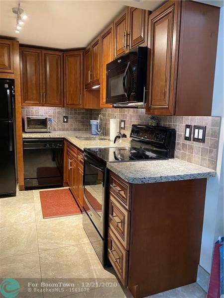 1428 SE 4th Ave B-210, Deerfield Beach, FL 33441 (MLS #F10262637) :: Berkshire Hathaway HomeServices EWM Realty