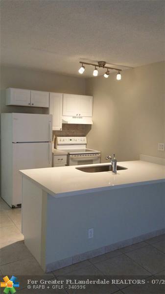 2501 Riverside Dr #103, Coral Springs, FL 33065 (MLS #F10127510) :: Green Realty Properties