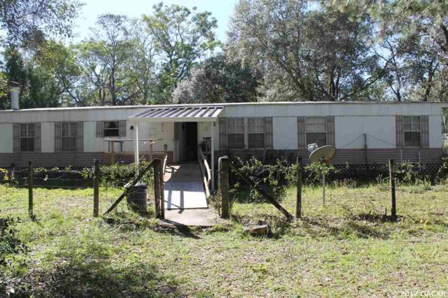 130 Oakwood Village Lane, Hawthorne, FL 32640 (MLS #409421) :: Thomas Group Realty