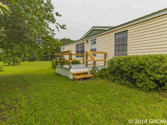 9402 SW 93rd Terrace, Gainesville, FL 32608 (MLS #415772) :: Thomas Group Realty