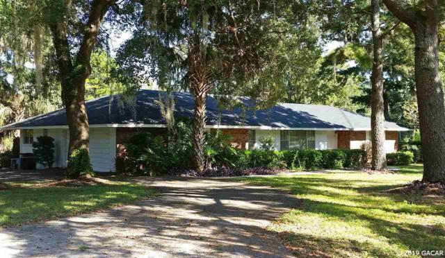 7001 SW 30th Way, Gainesville, FL 32608 (MLS #425163) :: Bosshardt Realty