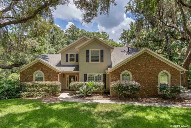 10709 NW 67TH Way, Alachua, FL 32615 (MLS #426574) :: Bosshardt Realty