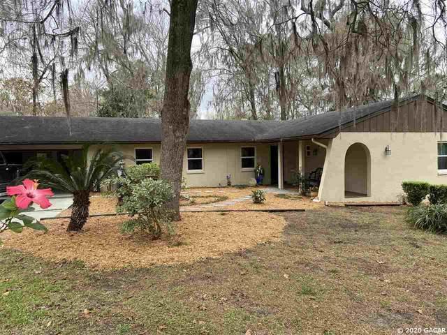 516 NW 101 Terrace, Gainesville, FL 32607 (MLS #432271) :: Abraham Agape Group