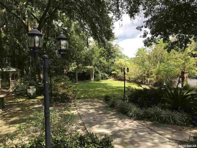 604 NW 75TH Street, Gainesville, FL 32607 (MLS #435647) :: The Curlings Group