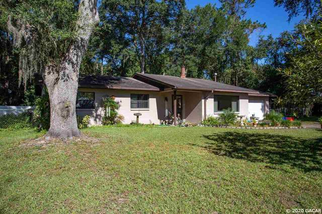 5014 NW 40th Terrace, Gainesville, FL 32606 (MLS #439420) :: The Curlings Group