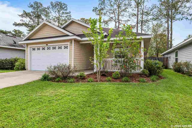 6053 NW 117TH Place, Alachua, FL 32615 (MLS #439771) :: The Curlings Group