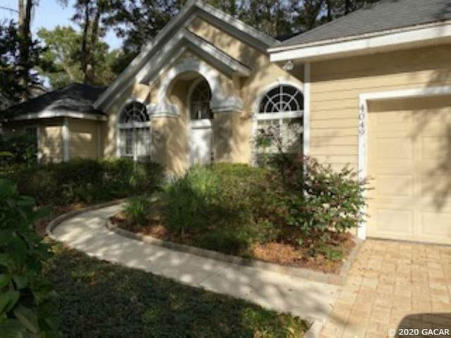 4049 SW 98 Terrace, Gainesville, FL 32608 (MLS #439996) :: The Curlings Group