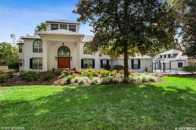 7815 NW 20TH Lane, Gainesville, FL 32605 (MLS #442570) :: The Curlings Group