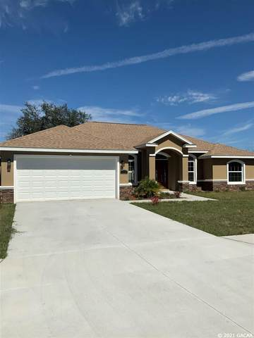 4955 SW 116 Place, Ocala, FL 34476 (MLS #443333) :: The Curlings Group