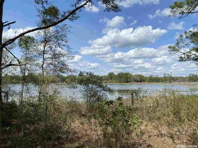 120 Junior Lake Trail, Interlachen, FL 32148 (MLS #444539) :: Abraham Agape Group