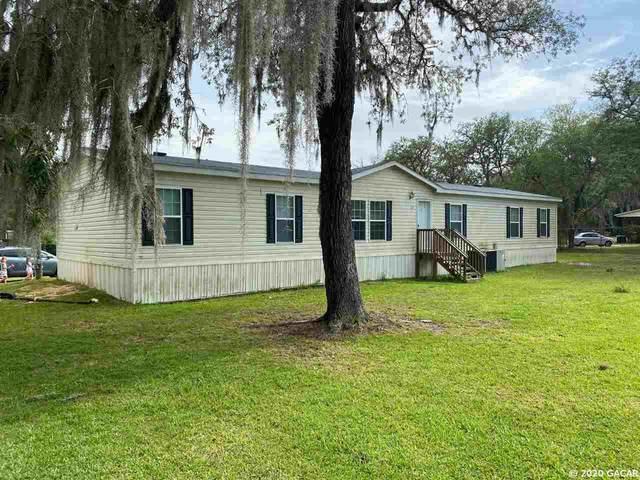 129 Woodland Lane, Hawthorne, FL 32640 (MLS #436057) :: Better Homes & Gardens Real Estate Thomas Group