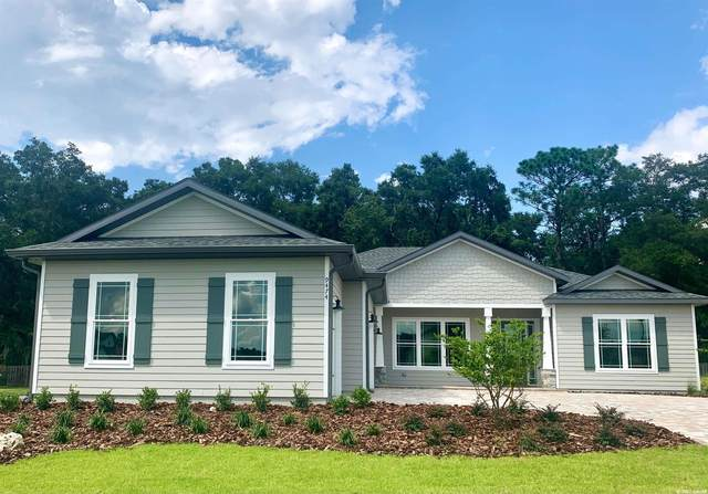 9474 SW 65th Place, Gainesville, FL 32608 (MLS #443010) :: The Curlings Group