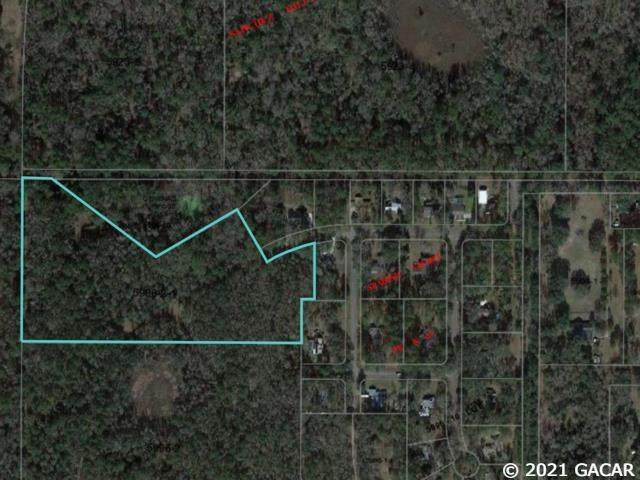 7122 NW 92nd Place, Alachua, FL 32615 (MLS #445252) :: The Curlings Group