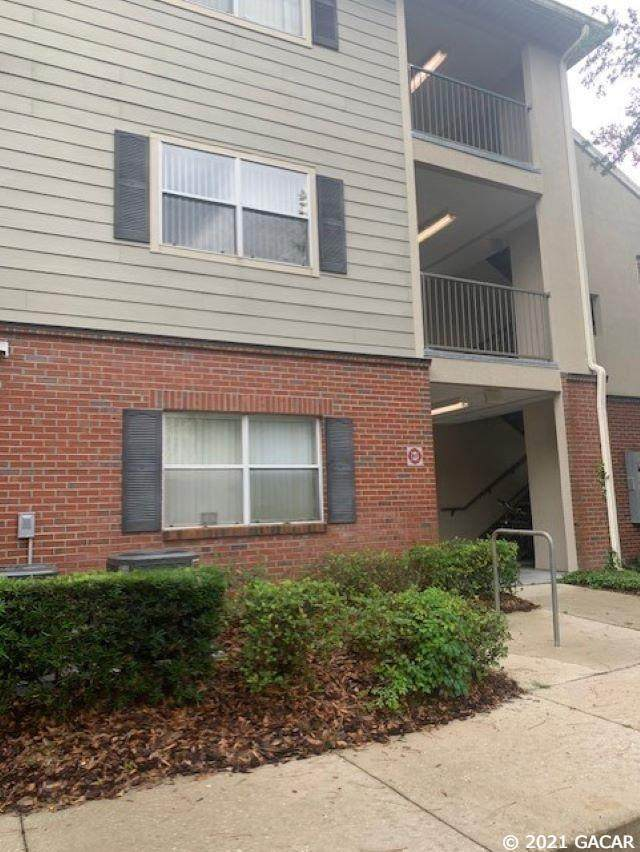 2360 SW Archer Road #701, Gainesville, FL 32608 (MLS #445255) :: The Curlings Group