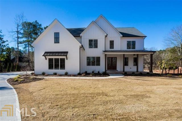 14220 Cogburn Rd, Milton, GA 30004 (MLS #8392738) :: The Durham Team
