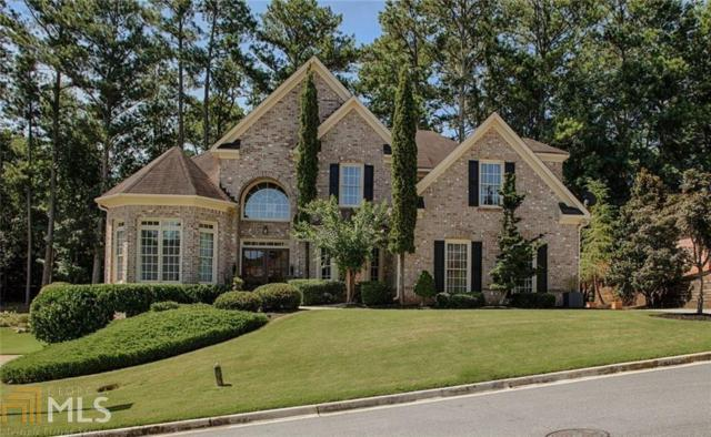 11240 Donnington Dr, Johns Creek, GA 30097 (MLS #8433686) :: Keller Williams Realty Atlanta Partners
