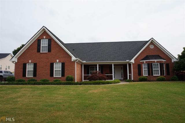 1405 Hidden Cv, Loganville, GA 30052 (MLS #8598588) :: The Heyl Group at Keller Williams