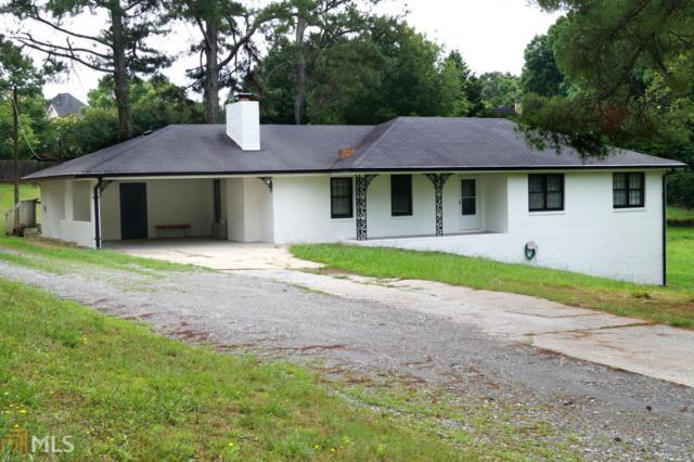 13975 Cogburn Rd, Milton, GA 30004 (MLS #8603297) :: The Heyl Group at Keller Williams