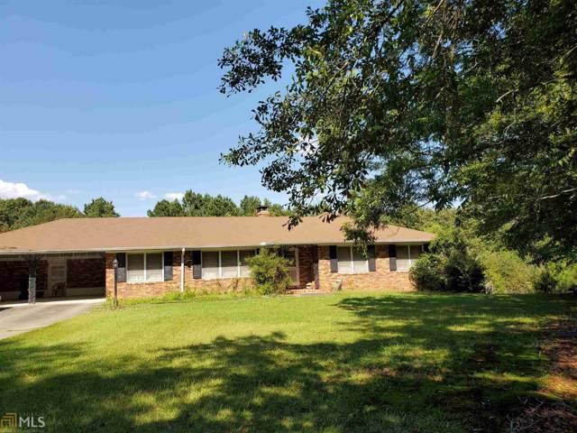 3221 Thompson Mill Rd, Buford, GA 30519 (MLS #8643776) :: Buffington Real Estate Group