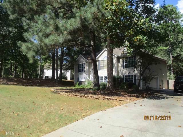 302 Strathmore Dr, Sharpsburg, GA 30277 (MLS #8660636) :: The Heyl Group at Keller Williams