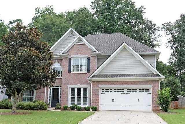 4907 Cedar Wood Dr, Lilburn, GA 30047 (MLS #8859219) :: Buffington Real Estate Group