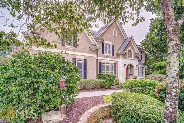 5009 Hickory Hills Dr, Woodstock, GA 30188 (MLS #8859894) :: Military Realty