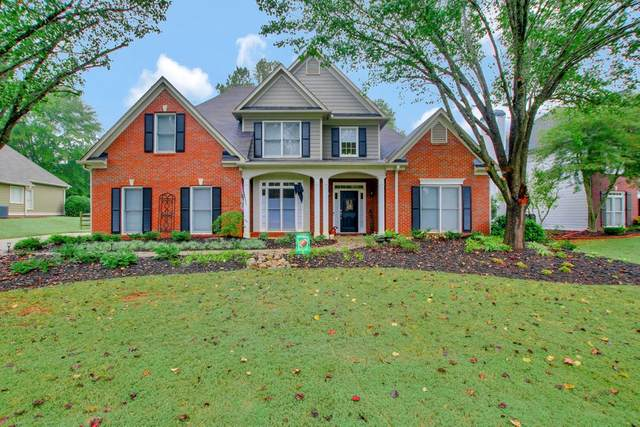 2064 Woodside Park Dr, Woodstock, GA 30188 (MLS #8881458) :: Military Realty