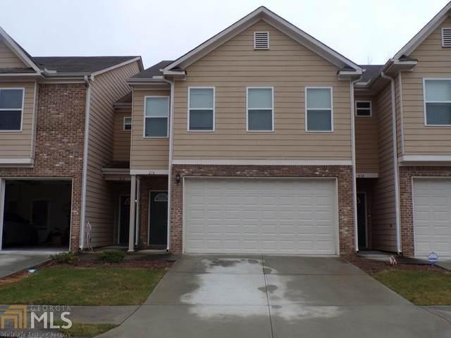 216 Oakland Hills Way, Lawrenceville, GA 30044 (MLS #8896443) :: Tim Stout and Associates