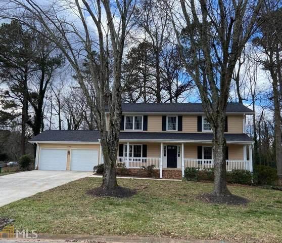 1196 Spring Mill Dr, Lilburn, GA 30047 (MLS #8914017) :: Regent Realty Company
