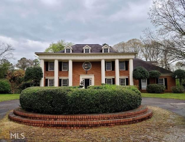 1216 Pleasant Hill Rd, Lawrenceville, GA 30044 (MLS #8949625) :: Rettro Group