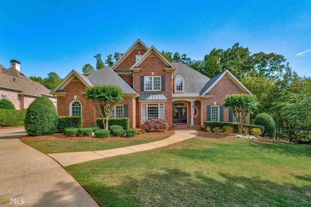 7115 Laurel Oak Dr, Suwanee, GA 30024 (MLS #8974018) :: The Durham Team